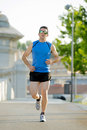 Young athletic man running on urban city park in summer sport training session with sunglasses practicing background body and Stock Photos