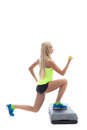 Young athletic model doing aerobics on stepper in studio Stock Photos