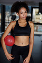Young athletic woman having a rest after fitness training at gym portrait of pretty fit girl in sport clothes holding balance ball Stock Photos