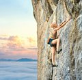 Young athletic woman rock climber climbing on the cliff Royalty Free Stock Photo