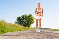 Young athletic woman running on the road exercise outdoors Stock Photos