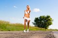Young athletic woman running on the road exercise outdoors Royalty Free Stock Photo