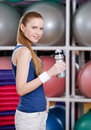 Young athletic woman in sportswear holds a water bottle portrait of confident holding gym Royalty Free Stock Images