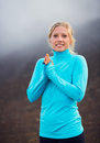 Young attractive athletic woman, wearing sporty cloths on trail