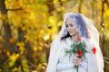 Young attractive bride with poppies in the hands Royalty Free Stock Photo