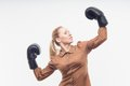 Young attractive business woman with boxing gloves celebrating win isolated on white background Stock Photos