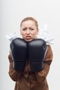 Young attractive business woman with boxing gloves and crumpled paper isolated on white background Stock Photo