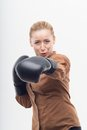 Young attractive business woman with boxing gloves ready for battle striking into the camera isolated on white background Stock Images