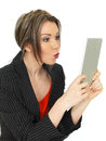Young attractive business woman holding a tablet dslr royalty free image in front of her face pouting while using social media Stock Photos