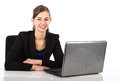 Young attractive business woman sitting behind a desk Royalty Free Stock Photo