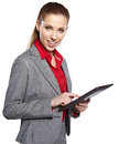 Young attractive business woman uses a mobile tablet computer with touch screen Stock Photography