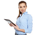 Young attractive business woman uses a mobile tablet computer with touch screen Stock Images