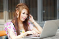 Young attractive business woman working on her laptop at outdoor Royalty Free Stock Images