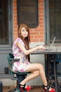 Young attractive business woman working on her laptop at outdoor Royalty Free Stock Image