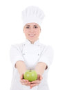 Young attractive cook woman in uniform with green apple   isolat Royalty Free Stock Images