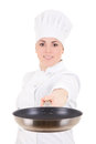 Young attractive cook woman in uniform with teflon frying pan is Stock Photo