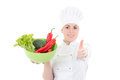 Young attractive cook woman in uniform with vegetables thumbs up Stock Photography