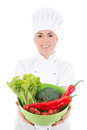 Young attractive cook woman in uniform with vegetarian food isol Royalty Free Stock Photography