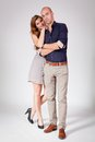 Young attractive couple in love embracing portrait on grey backgound Royalty Free Stock Photo