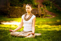 Young attractive female meditate in nature on beautiful summer day Royalty Free Stock Images