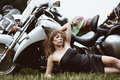 Young attractive girl and motorcycle Stock Photos