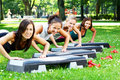 Young and attractive girls doing fitness exercises Stock Image