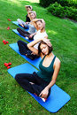 Young and attractive girls doing fitness exercises Royalty Free Stock Photos