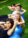 Young and attractive girls doing fitness exercises Stock Images