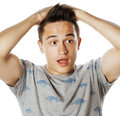 Young attractive handsome man holding hands on his head emotional wondering isolated on white Royalty Free Stock Photo