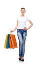 Young, attractive and happy shopping girl with bags