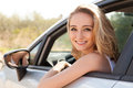 Young attractive happy woman sitting in car summer portrait outdoor Royalty Free Stock Photos