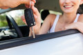 Young attractive happy woman sitting in car summer portrait outdoor Royalty Free Stock Photo