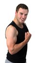 Young attractive man flexing his biceps Royalty Free Stock Photography