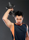 Young attractive man pumping weights handsome lifting weight Stock Photo
