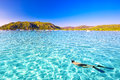 Young attractive man snorkeling in green lagoon in Santa Giulia Royalty Free Stock Photo