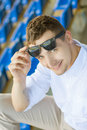 Young attractive man at the stadium vertical frame Stock Photography