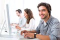 Young attractive man working in a call center Royalty Free Stock Photo