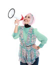 Young attractive muslim woman shouting using megaphone isolated over white background Royalty Free Stock Images