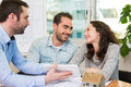 Young attractive people meeting real estate agent at the office Royalty Free Stock Photo