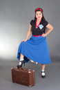 Young attractive pinup girl posing retro suitcase Stock Images