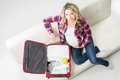Young attractive pregnant woman packing children's wear Royalty Free Stock Photo