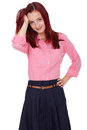 Young attractive redhead female in pink shirt Stock Photos