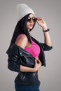 Young attractive stylish brunette model posing with sunglasses Royalty Free Stock Photo