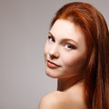 Young attractive woman beautiful long red health hair of Stock Image