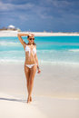The young attractive woman in bikini on a beach Royalty Free Stock Photo