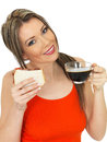 Young attractive woman with a black coffee and bacon sandwich dslr royalty free image happy holding glass cup of on white bread Stock Photo