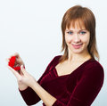 Young attractive woman with a box for rings in evening dress Royalty Free Stock Photos