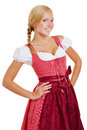 Young attractive woman in dirndl bavarian a with arms akimbo Royalty Free Stock Photo