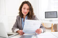 Young attractive woman doing paperwork view of a Stock Photography