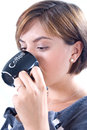 Young attractive woman drinks coffee Stock Photography